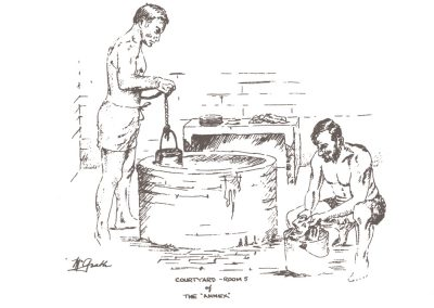 Two men in a courtyard washing their hands